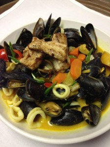 Caribbean Curry Bowl – Shrimp, mussels, calamari, and our freshest fish in a coconut curry broth over vegetable rice